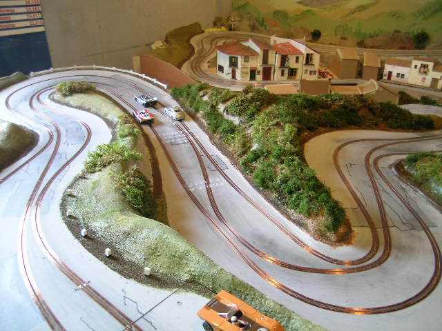 Layouts together with  together with 1 24 Slot Car Track Wiring additionally 463730092851724716 moreover Carrera Slot Car Track Layouts Car Pictures. on landscaped slot car track